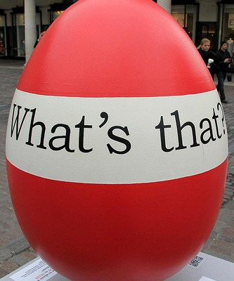 "Giant Egg with ""What's that?"" banner"