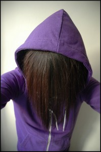 anonymous in a purple hoodie