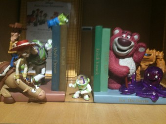 Woody, Buzz Lightyear, and friends Amid the Bookends