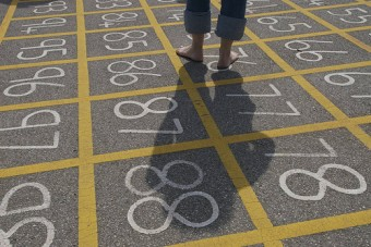 Barefoot Child in a Grid of Numbers